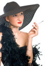 Women in black hat and boa with a cigarette Royalty Free Stock Photo