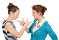 Women blame closeup portrait two mad angry with bad attitudes getting into argument fighting pointing fingers at each other Stock Photos