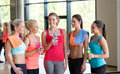 Women with bottles of water in gym Royalty Free Stock Photo