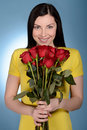 Women with bunch of roses beautiful middle aged women holding a woman red while isolated on blue Stock Images