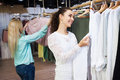 Women buying dress Royalty Free Stock Photo