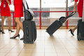 Women carries their luggage at the airport Royalty Free Stock Photo