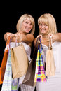 Women carrying shopping bags Royalty Free Stock Photos