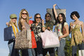 Women carrying shopping bags outdoors group of multiethnic young Royalty Free Stock Images