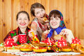 Women  celebrating Shrovetide and eats pancake Stock Image