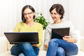 Women chat browsing home personal computer Royalty Free Stock Photo