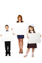 Women and children hold a poster studio white background Royalty Free Stock Photography