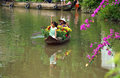 Women and children on rowboat with flower fortet in springtime sa dec viet nam asia jan spring come rowing the river to carry Royalty Free Stock Photos