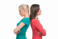 Women confrontation two angry standing back to back and holding their arms crossed while isolated on white Royalty Free Stock Photos