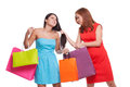 Women confrontation young red hair grabbing hair of another and trying to get her shopping bags Royalty Free Stock Image