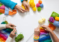 Women crochet and knitting from colored yarn. View from above. Royalty Free Stock Photo