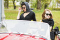 Women with dark glasses behind car windscreen pretty Stock Photos