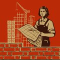Women day female worker holding blueprints on construction background Royalty Free Stock Photography