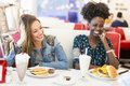 Women in the diner Royalty Free Stock Photo