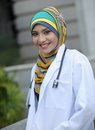 Women doctor scarf smile Stock Images