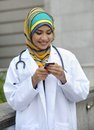 Women doctor scarf smile Stock Photos