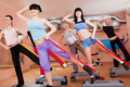 Women doing aerobic workout Royalty Free Stock Images