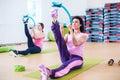 Women doing exercises warming up leg stretching workout Royalty Free Stock Photo