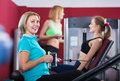 Women doing powerlifting on machines Royalty Free Stock Photo