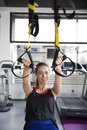 Women doing push ups training arms with trx fitness straps Royalty Free Stock Photo