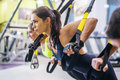 Women doing push ups training arms with trx Royalty Free Stock Photo