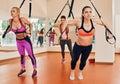 Women doing push ups training arms trx Royalty Free Stock Photo