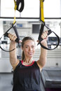 Women doing push ups training arms with trx fitness straps in th Royalty Free Stock Photo