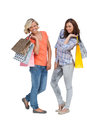 Women doing shopping and holding bags on white background Royalty Free Stock Images