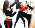 Women doing sport in gym, healthcare lifestyle happy people concept, modern loft studio, flying in jump