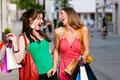 Women downtown shopping with bags Stock Photography