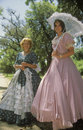 Women dressed in period piece costumes of the Old South, Charleston, SC