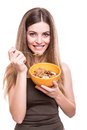 Women eating cereals beautiful young woman over white background Royalty Free Stock Image
