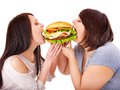 Women eating hamburger. Stock Photography