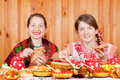 Women  eating pancake during  Shrovetide Stock Photos