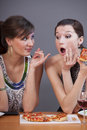 Women eating pizza Royalty Free Stock Photos