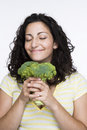 Women enjoying broccoli Royalty Free Stock Images