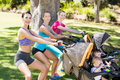 Women exercising with baby stroller Royalty Free Stock Photo