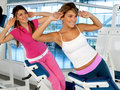 Women exercising at the gym Stock Photo