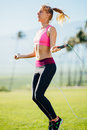 Women exercising jumping rope attractive young fitness Stock Photo