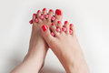 Women feet after pedicure with red nails on white background Stock Image
