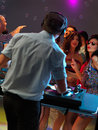 Women flirting with dj in night club Royalty Free Stock Photos