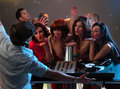 Women flirting with dj in night club Stock Images