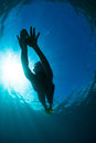 Women free diving Stock Photo