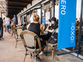 Women friends sit at caffe nero table outside oxo tower wharf s london england august south bank on a summer afternoon Royalty Free Stock Photos