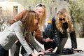 Women friends working with laptop outdoor Royalty Free Stock Photo