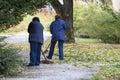 Women Gardener raking fall leaves Royalty Free Stock Photo