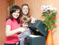 Women and girl uses humidifier Royalty Free Stock Photography