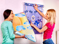 Women glues wallpaper at home happy two indoor Stock Image