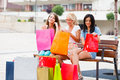 When women go shopping blond and brunette happy girlfriends out in city for a with lots of bags Royalty Free Stock Images