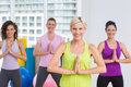 Women with hands joined exercising at gym portrait of happy fit Royalty Free Stock Images